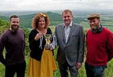"Brains behind ""The Finest View"" land art presented with Tour de Yorkshire competiton winner's trophy"
